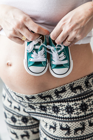 35 40 years old: Pregnant belly with slippers