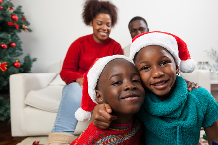 happy eating: Brothers hugging at christmas Stock Photo