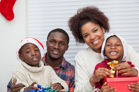 daugther: Family together doing gifts and smiling