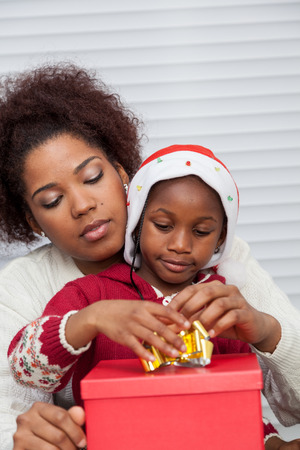 daugther: Mother and daughter preparing Christmas gifts