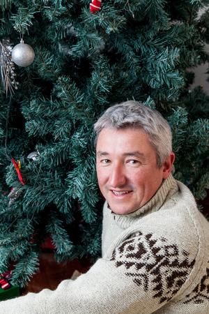 35 40: Man beside the christmas tree