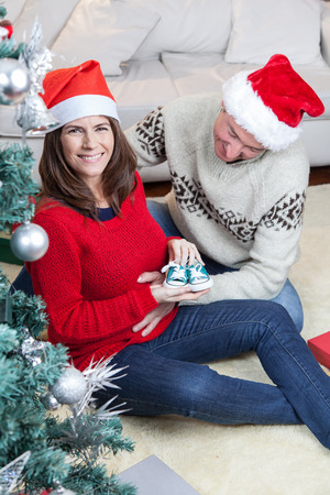 35 40 years old: Couple with little shoes in christmas