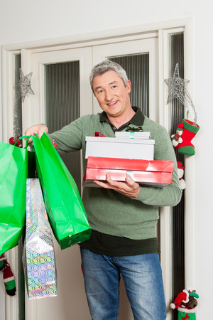 35 years old man: Man showing his gifts bag of christmas