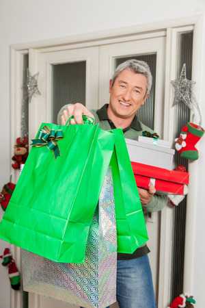 35 to 40 years old: Man holding a lot of giftbox