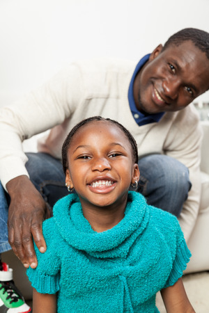 30 to 35 years old: Happy black girl in christmas with her dad