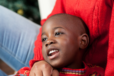 daugther: Portrait of black boy on Christmas