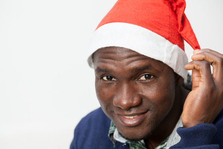 30 35 years: Portrait of man with Christmas hat Stock Photo