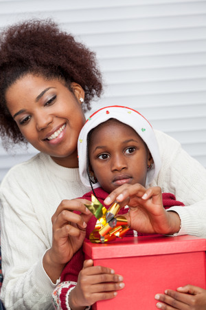 30 35 years: Mother and daughter preparing Christmas gifts
