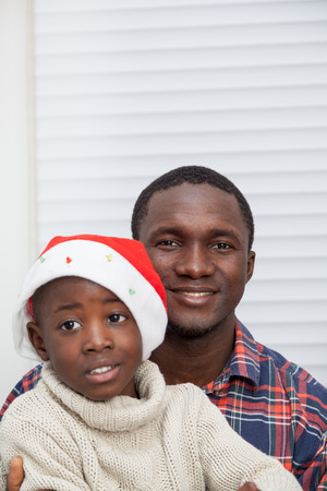 30 to 35: Portrait of father and son at Christmas Stock Photo