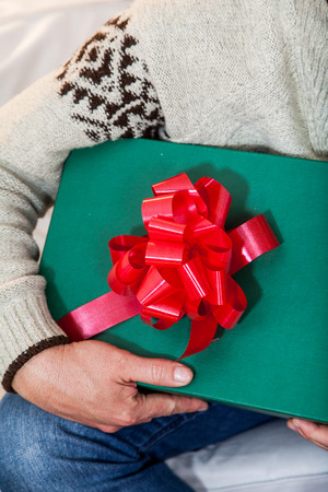 40 year old man: Man holding a giftbox Stock Photo