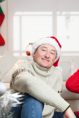 35 40 years old: Man sitting with a hat of christmas
