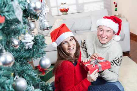 Couple laughing in christmas day photo