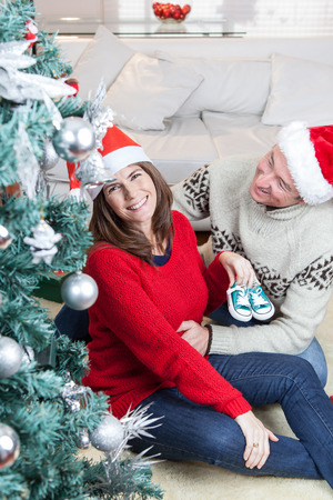 Couple with little shoes in christmas photo