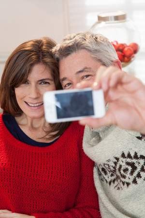35 40 years old: Couple making a selfie Stock Photo
