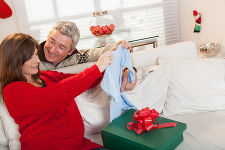 35 40 years: Pregnant opening gift with hes husband in christmas