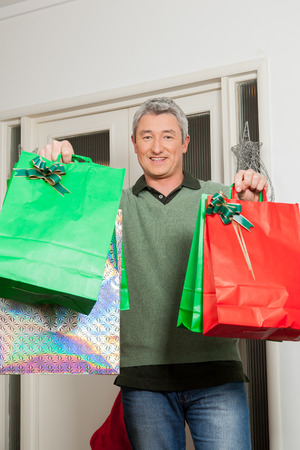 35 40 years old: Man with many gift bags