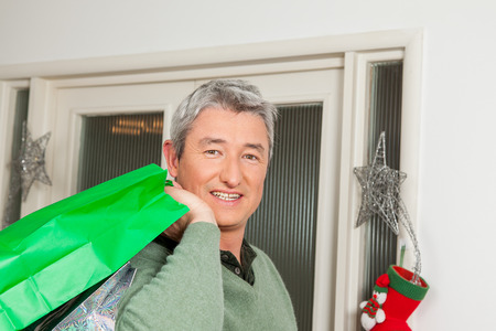 35 40 years old: Man holding a gift bag