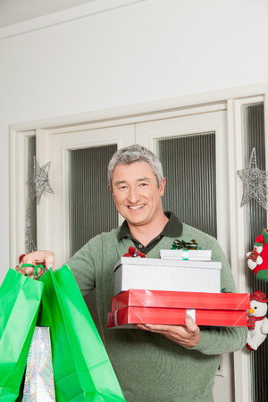 35 40 years old: Happy man showing his gifts bag of christmas Stock Photo