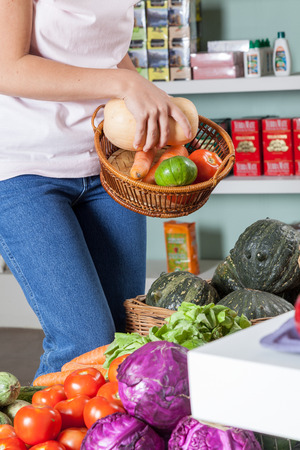 woman s bag: Woman clutching the vegetables Stock Photo