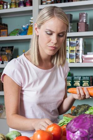 woman s bag: Natural Woman buying food Stock Photo