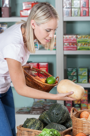 woman s bag: Woman choosing the vegetable Stock Photo