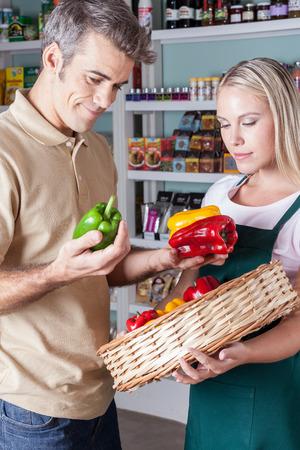 Man choosing the vegetables photo
