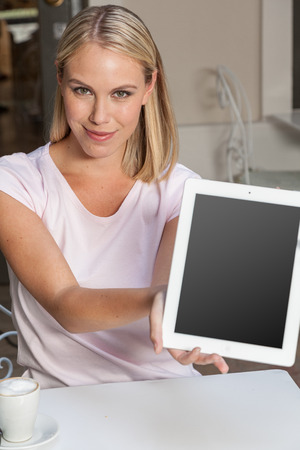 20 24 years old: Woman showing a tablet
