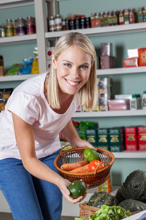 woman s bag: Natural Woman clutching food Stock Photo