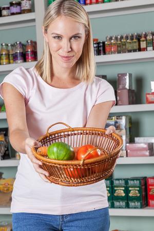 woman s bag: Woman showing a fruit