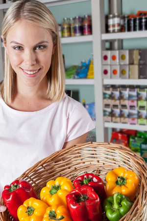 woman s bag: Woman showing vegetables Stock Photo