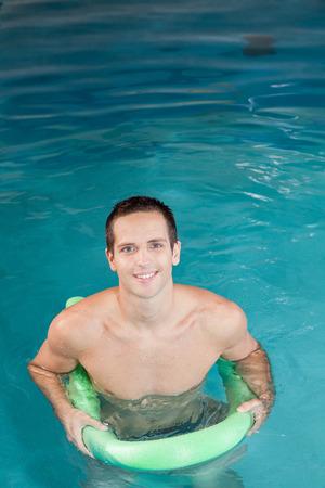 flotation: man inside the pool