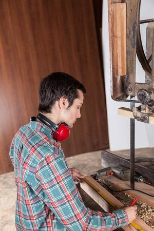profile measurement: carpenter working Stock Photo