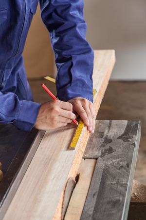 manual measuring instrument: carpenter working Stock Photo