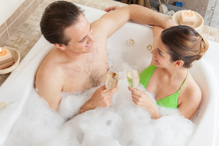 woman in bath: couple inside the tube