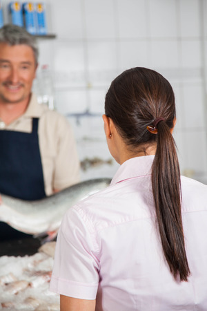 buying: woman buying a fish