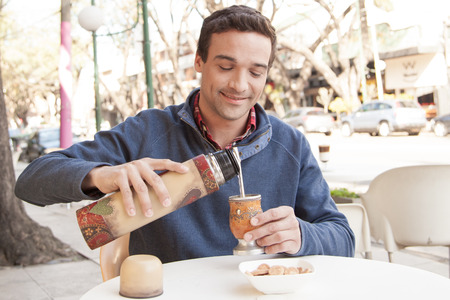 prime adult: Man drinking mate