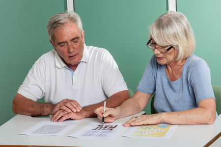 resolving: Old couple resolving a croossword