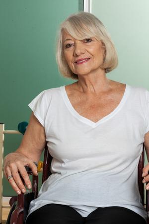 paraplegia: Portrait of elderly woman in wheelchair Stock Photo