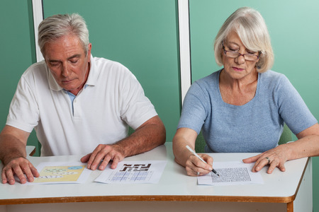 resolving: Old couple resolving a croosword