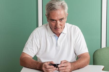 resolving: Old man resolving a crossword