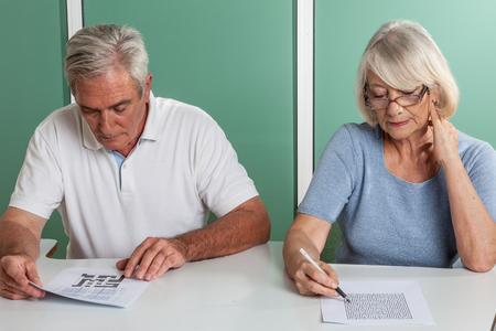 resolving: Old couple resolving a crossword