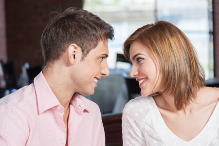 Man looks with love at woman