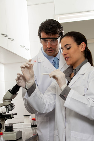 lab tech: Man and woman scientifics working in the lab Stock Photo