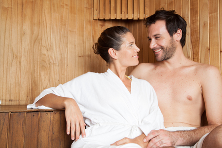 hot stones: Couple in love relaxing in the sauna Stock Photo