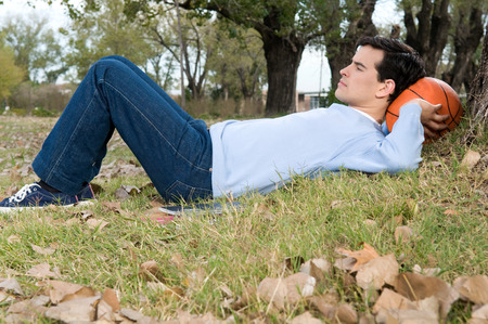 20 to 25 years old: Man resting outside