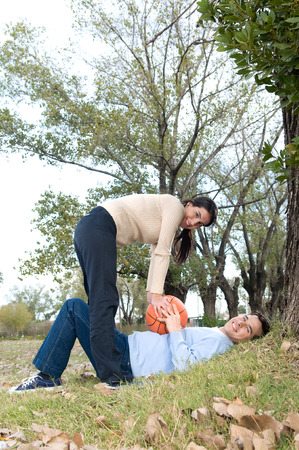 20 year old girl: Couple in love playing outside Stock Photo