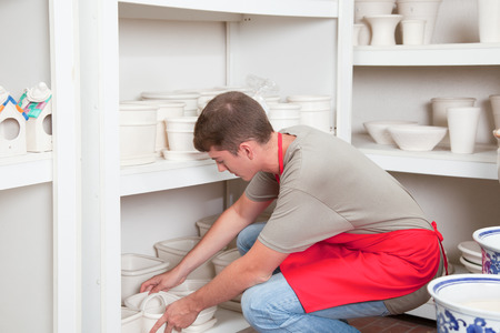 accommodating: Man accommodating the pots to sale