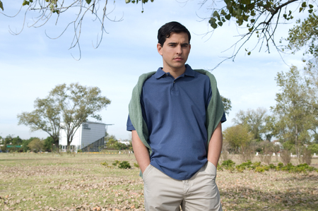 20 to 25 years old: Man walking outdoors Stock Photo