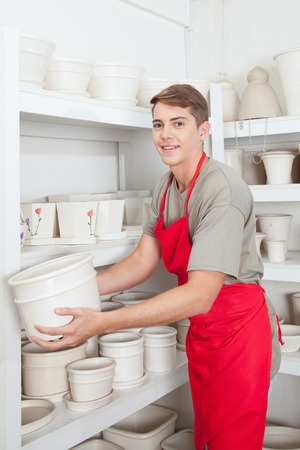 accommodating: Salesman accommodating the pots Stock Photo
