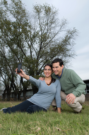 20 25 years: Couple taking a photo